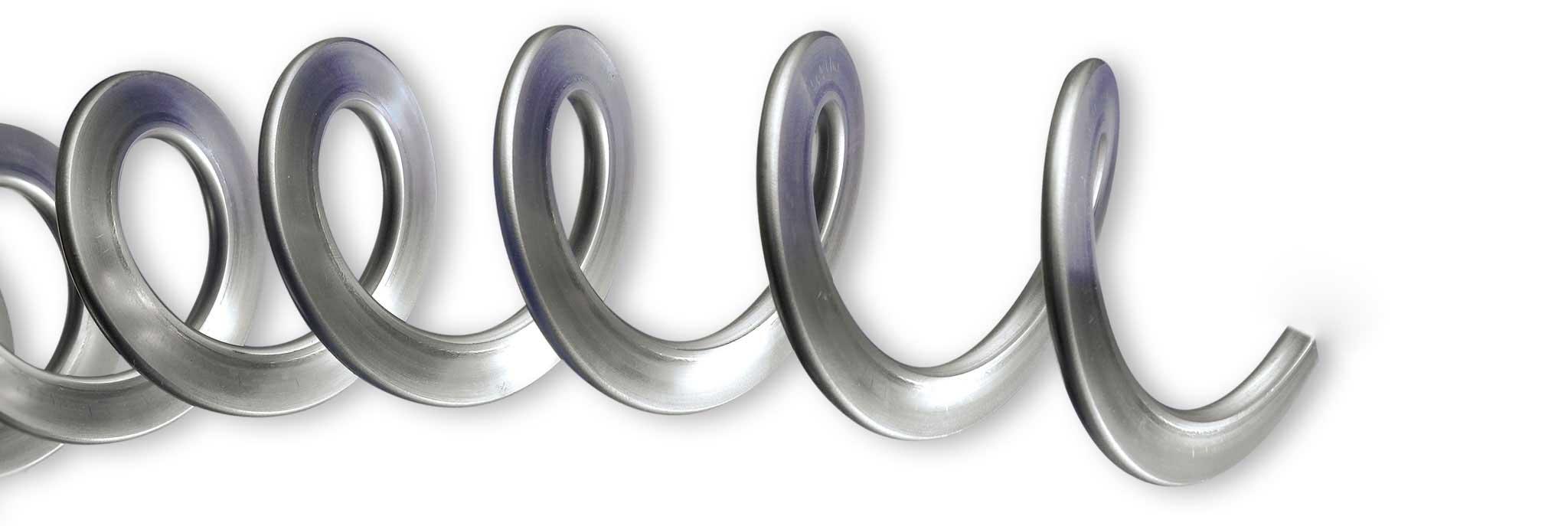 Spirali flessibili in acciaio per trasporto cippato, biomasse per caldaie e mangimi per impianti zootecnici di alimentazione automatica